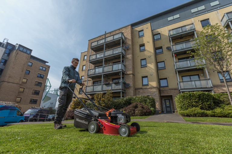Snowdrop Cleaning Services offering professional grounds maintenance. This covers various tasks including grass cutting and litter picking.